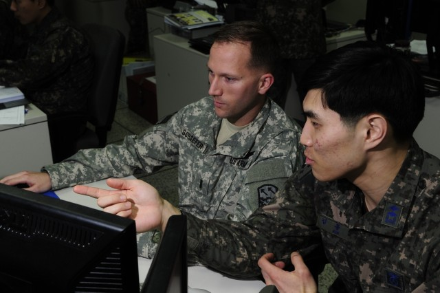 Army 1st Lt. Michael Schaefer (left), a battle captain for the 94th Army Air and Missile Defense Command, conducts air and missile defense operations with 1st Lt. Dong-jun Kim (right) a battle captain with the Republic of Korea air force. The lessons learned from Key Resolve will be used to improve integration and combined plans between the two nations' air defense units to ensure that South Korea is properly protected from air and missile attacks by belligerent nations.  (U.S. Air Force photo by Staff Sgt. Nick Wilson/Released)