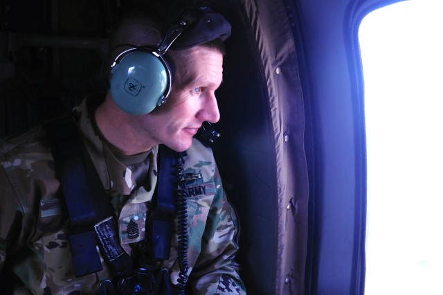 Sgt. Maj. of the Army Daniel Dailey takes in the sites of Seoul out the window of a UH-60 Black Hawk helicopter, April 6. This is Dailey's first time visiting Korea since he was stationed at Camp Casey as a staff sergeant in 1996.