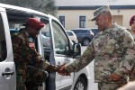 Maj. Gen. Darryl A. Williams, U.S. Army Africa commander, shakes hands with Brig. Gen. Daniel Dee Ziankahn, Armed Forces of Liberia chief of staff, during a welcoming ceremony at USARAF's headquarters building, Caserma Ederle, Vicenza, Italy, April 4, 2016. The visit was an opportunity for both senior leaders to strengthen the partnership between their two militaries. Discussions and meetings took place to review past, current and future partnership opportunities. (U.S. Army Africa photo by Spc. Craig Philbrick)