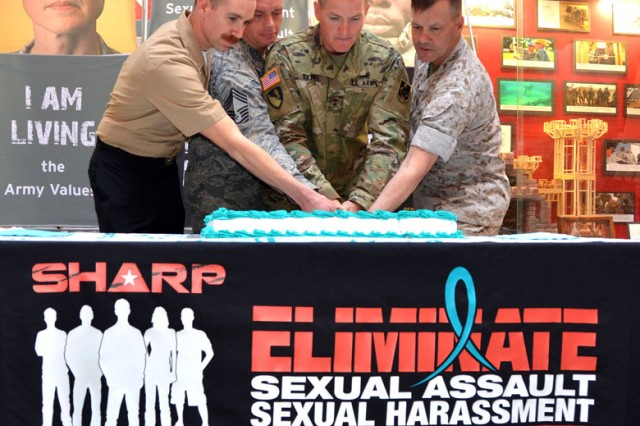 Fort Leonard Wood kicked off Sexual Assault Awareness Prevention Month with a joint ceremony. Pictured, Navy Petty Officer 1st Class Clinton Burch, Air Force Chief Master Sgt. Philip Donoho and Marine Lt. Col. Daniel Dubbs assisted Maj. Gen. Kent Savre, center, Maneuver Support Center of Excellence and Fort Leonard Wood commanding general, in the cutting of the cake.