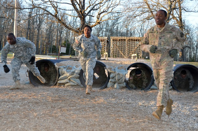 Capt. Tameika Dawson (center) and Staff Sgt. Demitri Holder (right) compete with other staff and officers of 3rd Chemical Brigade in Operation Phoenix Forge.