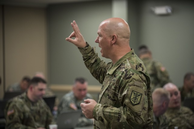 Sgt. 1st Class Donald Snow, the schools and training noncommissioned officer for the 200th Military Police Command, runs a workshop with the command's subordinate brigades and battalions during a four-day workshop and Yearly Training Brief conference held in Columbus, Ohio, on March 31. During the event, the units' leaders worked to improve their readiness and briefed the commanding general and his command leadership on their units' status. (U.S. Army photo by Master Sgt. Michel Sauret)
