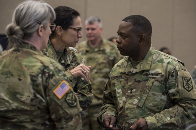 Maj. Gen. Phillip Churn (right), commanding general of the 200th Military Police Command, speaks with his deputy commanding generals, Brig. Gen. Marion Garcia and Brig. Gen. Kelly Wakefield, during a four-day workshop and Yearly Training Brief conference held by the 200th MP Cmd. in Columbus, Ohio, on April 2. During the event, battalion and brigade leaders worked to improve their readiness and briefed the commanding general and his command leadership on their units' status. (U.S. Army photo by Master Sgt. Michel Sauret)
