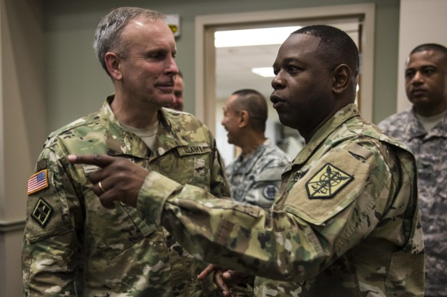 Maj. Gen. Phillip Churn (right), commanding general of the 200th Military Police Command, speaks with Brig. Gen. Phillip Jolly, with the Army Reserve Engagement Cell (AREC), U.S. Army Europe, Germany, during a four-day workshop and Yearly Training Brief conference held by the 200th MP Cmd. in Columbus, Ohio, beginning March 31. During the event, the units' leaders worked to improve their readiness and briefed the commanding general and his command leadership on their units' status. AREC members from various Army Service Component Commands attended this YTB in order to grow partnerships between the 200th MP Cmd. and Army component commands across the globe. (U.S. Army photo by Master Sgt. Michel Sauret)