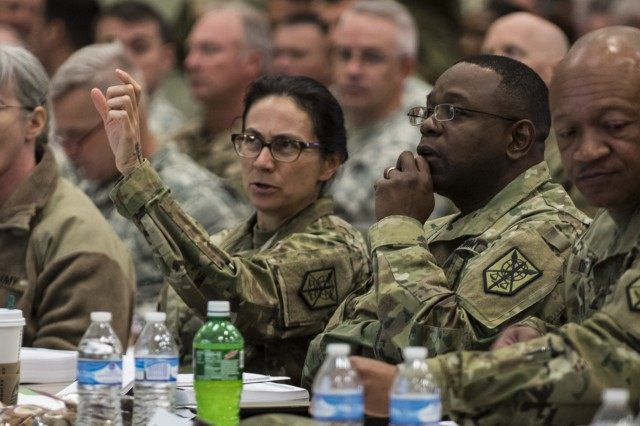 Maj. Gen. Phillip Churn (right), commanding general of the 200th Military Police Command, and Brig. Gen. Marion Garcia, deputy commanding general (operations), discuss information posted on a screen during a four-day workshop and Yearly Training Brief conference held by the 200th MP Cmd. in Columbus, Ohio, on April 2. During the event, battalion and brigade leaders worked to improve their readiness and briefed the commanding general and his command leadership on their units' status. (U.S. Army photo by Master Sgt. Michel Sauret)