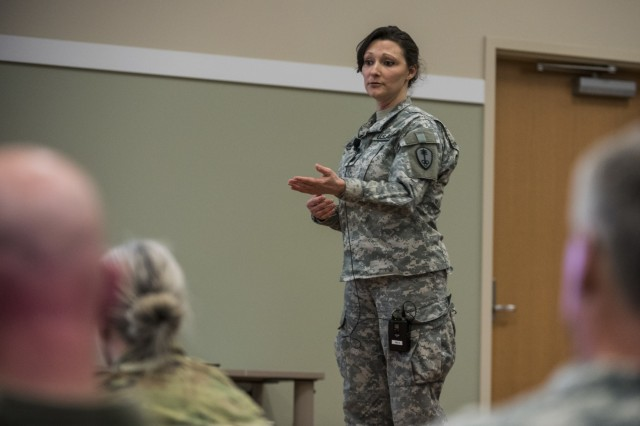 Lt. Col. Shelly Gabriel, U.S. Army Reserve commander of the 391st Military Police Battalion, of Columbus, Ohio, briefs the 200th Military Police Command headquarters leadership and senior staff during a Yearly Training Brief conference held in Columbus, Ohio, on April 3. During the event, battalion and brigade leaders worked to improve their readiness and briefed the commanding general and his command leadership on their units' status. (U.S. Army photo by Master Sgt. Michel Sauret)