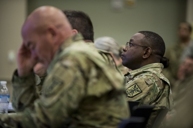 Maj. Gen. Phillip Churn, commanding general of the 200th Military Police Command, listens to a battalion briefing on the final day of a Yearly Training Brief conference held in Columbus, Ohio, April 3. During the event, battalion and brigade leaders worked to improve their readiness and briefed the commanding general and his command leadership on their units' status. (U.S. Army photo by Master Sgt. Michel Sauret)
