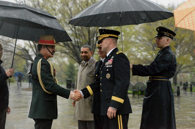 Maj. Gen. Bradley A. Becker, commanding general, U.S. Army Military District of Washington, and U.S. Army Vice Chief of Staff Gen. Daniel B. Allyn welcome Gen. Dalbir Singh, Chief of the Army Staff, Indian Army, during an Army Full Honor Wreath-Laying Ceremony at the Tomb of the Unknown Soldier in Arlington National Cemetery, Va., April 7, 2016.