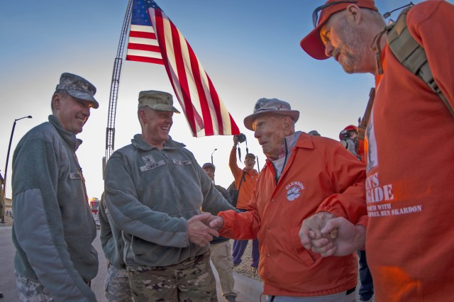 U.S. Army Brig. Gen. Timothy R. Coffin, commander of White Sands Missile Range, greets retired Col. Ben Skardon, 98, a survivor of the Bataan Death March, before the start of the Bataan Memorial Death March, March 20, 2016. Skardon is the only survivor who walks in the march, going more than eight miles nine years in a row. (U.S. Army photo by Staff Sgt. Ken Scar)