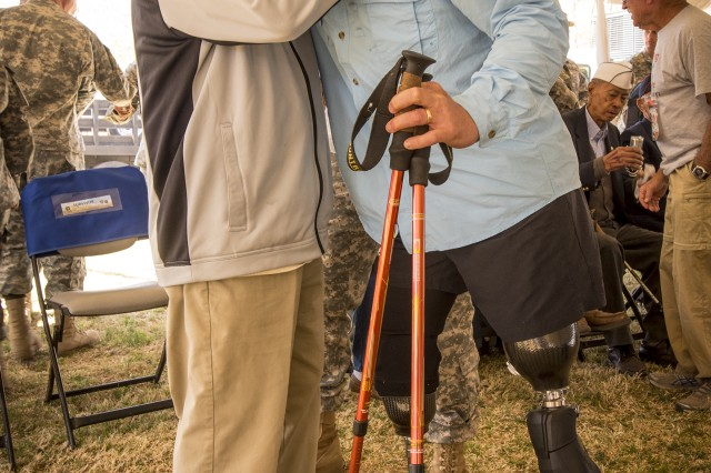 Former Navy Special Operations Master Chief Harold Bologna, a double amputee, embraces retired U.S. Army Col. and Bataan Death March Survivor Ben Skardon after they each walked more than eight miles in the Bataan Memorial Death March at White Sands Missile Range, N.M., March 20, 2016. (U.S. Army photo by Staff Sgt. Ken Scar)