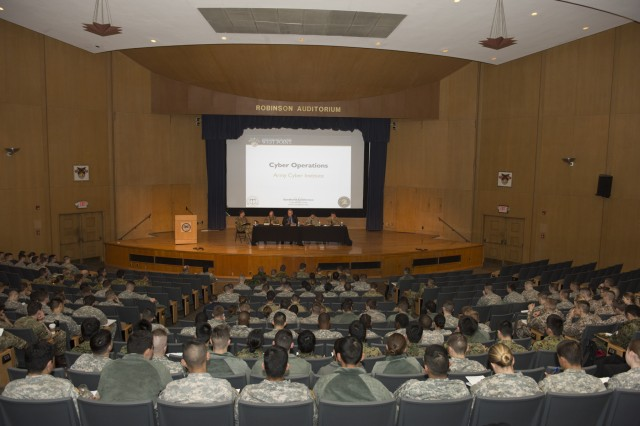 Faculty members from West Point's Army Cyber Institute conduct a panel discussion on cyber operations at the Sandhurst Conference at West Point, N.Y., April 4, 2016.