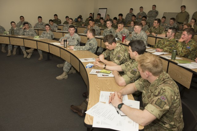 Cadets from different countries and commissioning sources discuss modern warfare topics at West Point's inaugural Sandhurst Conference hosted by the Modern War Institute, April 4, 2016.