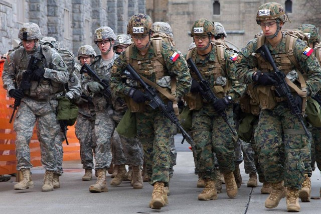 Cadets from Chile's Escuela Militar and cadets from the U.S. Military Academy E1 team step off of the starting line at the 2016 Sandhurst Competition at West Point, N.Y., April 8, 2016.