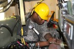 Spc. Abraham Keith of the 318th Chemical Co. out of Birmingham, Ala. works on loosening the engine from inside a humvee as he and his fellow students take apart the engine block and remove the humvee's engine as part of a training task during the first phase of the 80th Training Command's Wheeled Vehicle Mechanic Course at the Devens Regional Training Site Maintenance facility, 31 March 2016.   The three-week course teaches students the basics of how to perform maintenance and repairs on four-wheeled military vehicles, primarily focusing on humvees and Mine-Resistant Ambush Protected vehicles.