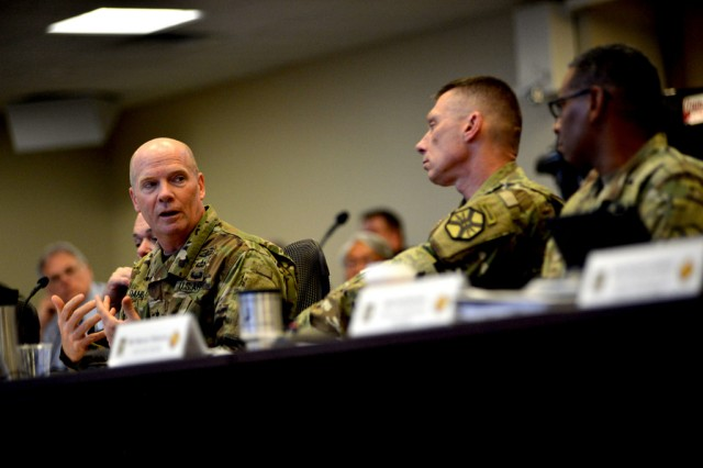 Lt. Gen. Kenneth Dahl (left), Commanding General of U.S. Army Installation Management Command, confers with IMCOM Command Sgt. Maj. Jeffrey Hartless (center) and IMCOM Deputy Commanding General for Operations and Chief of Staff for IMCOM Maj. Gen. Lawarren Patterson (right) during Cyber Installation Support Summit VI at the U.S. Army Installation Management Command Headquarters Operations Center, March 30, at Fort Sam Houston, Texas.