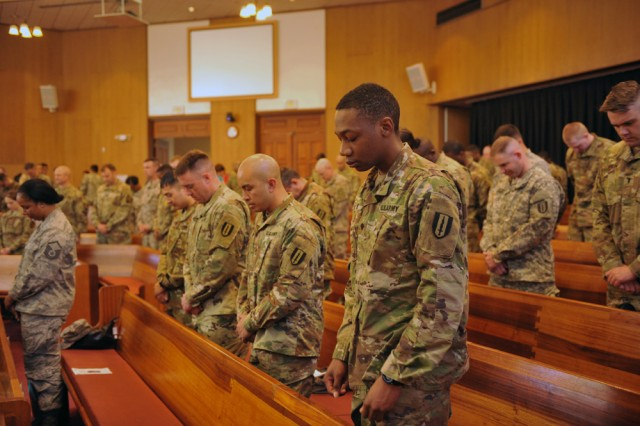 Eighth Army Deputy Commanding General for Sustainment, Maj. Gen. David Puster, signs a message to Soldiers about their role in eradicating sexual harassment and assault from the ranks during a training event at South Post Chapel, Yongsan Garrison, South Korea Apr. 4, 2016.