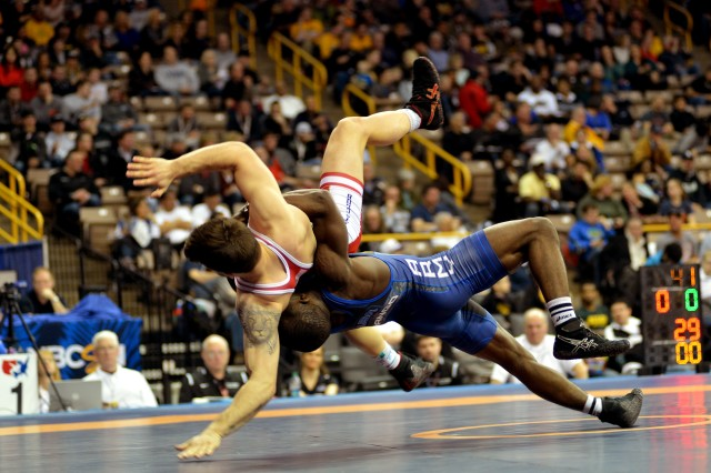 Sgt. Ryan Mango of the U.S. Army World Class Athlete Program throws Nikko Triggas of the New York Athletic Club in the Greco-Roman 59-kilogram division of the 2016 U.S. Olympic Wrestling Team Trials on April 9 at Carver-Hawkeye Arena in Iowa City, Iowa. (U.S. Army IMCOM photo by Tim Hipps)