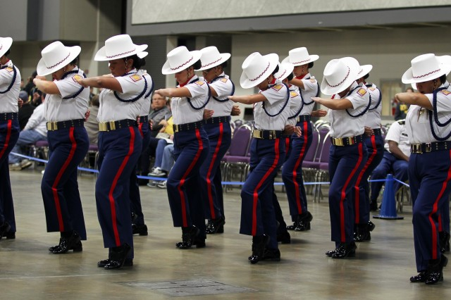 Members of the Theodore Roosevelt High School, San Antonio, Texas, JROTC program perform their Unarmed Exhibition Drill routine during the Army JROTC National Drill and Ceremony competition April 9. They went on to take first place in that category.