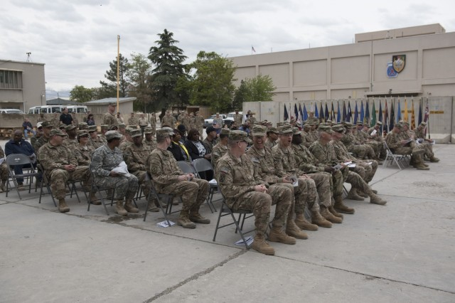 Service members and civilians wait in the Summit Garden at Bagram Airfield, Afghanistan for the U.S. Army Expeditionary Contracting Command transfer of authority ceremony, April 10, 2016