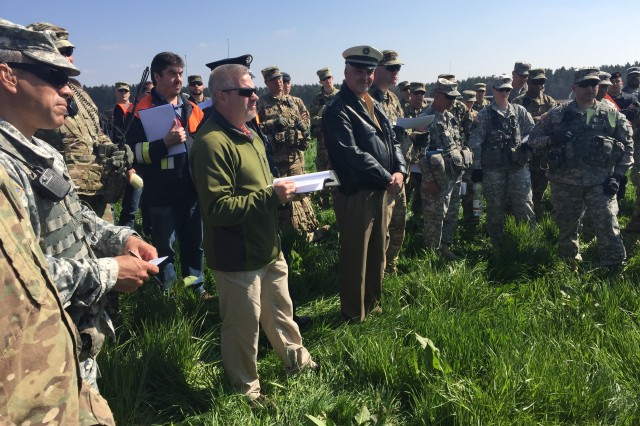 Ernest Roth , 7th Army Joint Multinational Training Command maneuver liaison officer, reviews safety procedures and maneuver damage prevention training with participating units and German authorities during the Saber Junction 16 rehearsal, April 11, 2016, for an airborne jump and tactical movement into maneuver rights area that will be held April 12 near Hohenfels, Germany.