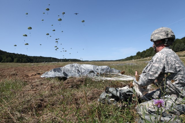 A U.S. Soldier assigned to the 1st Infantry Brigade, 82nd Airborne Division repacks his parachute while conducting airborne operations during exercise Swift Response 15 at the U.S. Army's Joint Multinational Readiness Center in Hohenfels, Germany, Aug. 26, 2015. During Saber Junction 16, nearly 1,000 multinational paratroopers will descend onto two maneuver rights areas drop zones near Hohenfels Training Area, April 12, 2016. (U.S. Army photo by Spc. Lloyd Villanueva/Released)