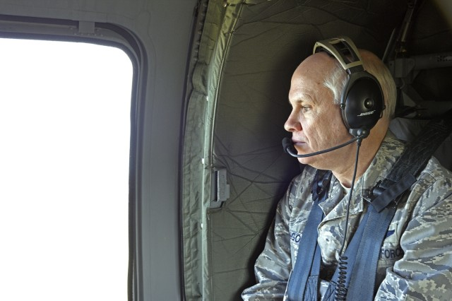 Brig. Gen. John McGoff, Indiana National Guard Assistant Adjutant, watches out of the window of the Indiana National Guard UH-60 Blackhawk during the Bold Quest 16.1 Distinguished Visitors Day, April 6.