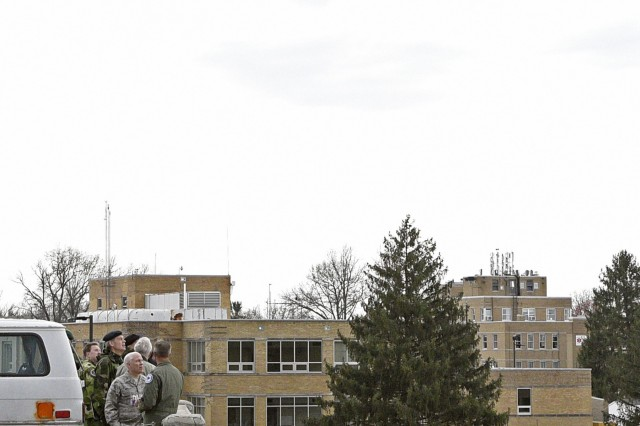 An Indiana National Guard A-10 from the 122nd Fighter Wing in Fort Wayne, Ind., performs a maneuver as dignitaries watch from the top of the collapsed parking structure at Muscatatuck Urban Training Center during the Bold Quest 16.1 Distinguished Visitors Day, April 6.