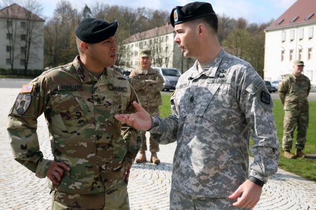 Command Sgt. Maj. Woody Carter, 52nd Signal Battalion outgoing senior enlisted advisor, speaks to Command Sgt. Maj. Danny Rebolledo, 52nd Signal Battalion incoming senior enlisted advisor, at the 52nd Signal Battalion change of responsibility ceremony April 7, 2016 at Patch Barracks in Stuttgart.