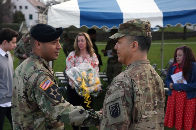 Command Sgt. Maj. Frank Gutierrez, 5th Signal Command (Theater) senior enlisted advisor, congratulates Command Sgt. Maj. Danny Rebolledo, 52nd Signal Battalion incoming senior enlisted advisor, at the 52nd Signal Battalion change of responsibility ceremony April 7, 2016 at Patch Barracks in Stuttgart.