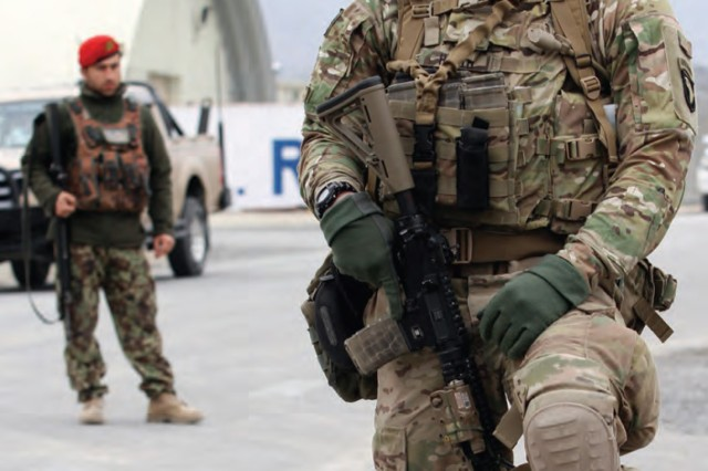 Pfc. Jeffrey Heath, a Soldier with 1st Battalion, 187th Infantry Regiment, 3rd Brigade Combat Team, 101st Airborne Division (Air Assault) (3-101 ABN), stands guard with a Soldier from the ANDSF in March 2015 at Tactical Base Gamberi in Afghanistan.