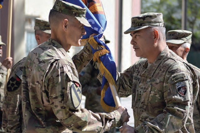 "Gen. John F. Campbell, then-commander of the Resolute Support Mission, passes the Combined Security Transition Command -- Afghanistan colors to Maj. Gen. Gordon B. ""Skip"" Davis Jr., Oct. 1, 2015, during the change-of-command ceremony at Resolute Support Headquarters in Kabul."