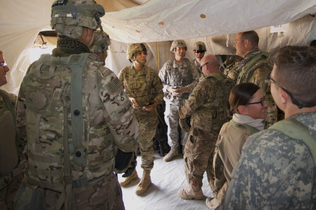 """FORT IRWIN, Calif. -- Lt. Gen. Nadja West (left), the 44th Army Surgeon General and commander, U.S. Army Medical Command, looks on as Soldiers from the 123rd Brigade Support Battalion out of Fort Bliss, Texas, provide treatment to """"wounded"""" during a mass casualty exercise April 9. The training, taking place at Fort Irwin, Calif., was part of a National Training Center rotation scenario testing their ability to perform under a simulated combat environment. """"Seeing Soldiers putting their knowledge, fitness and ingenuity into action, watching them build confidence through experience and being challenged by realistic training scenarios, that's what I want to see first-hand."""" West paused and added with satisfaction, """"It's also an opportunity for me to speak with and listen to what Soldiers are saying about training, which I enjoy."""" The goal of the training scenario -- a petrol generator malfunctions, explodes and causes 8 immediate heavy casualties requiring a variety of treatments and triage management - is to test readiness as well as hone emergency medical skills among the participating 3rd Brigade, 1st Armored Div. service members. Dual-hatted as the MEDCOM commanding general, West oversees more than 48 medical treatment facilities providing care to 3.8 million active-duty members of all services, retirees and their family members. She is also responsible for development, policy direction, organization and overall management of an integrated Army-wide health service system and is the medical materiel developer for the Army. To learn more about the people and facilities of the Weed Army Community Hospital and the National Training Center at Fort Irwin visit the WACH website at www.irwin.amedd.army.mil"""