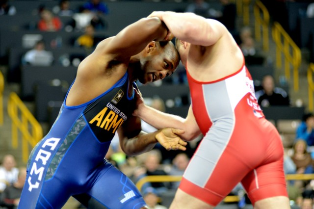 Sgt. Caylor Williams of the U.S. Army World Class Athlete Program was 38 seconds shy of earning an Olympic berth before dropping a 6-5 decision in the third match of a best-of-three series against Minnesota Storm's Josef Rau in the Greco-Roman 98-kilogram finals of the 2015 U.S. Olympic Wrestling Team Trials on April 9 at Carver-Hawkeye Arena in Iowa City, Iowa. (U.S. Army photo by Tim Hipps)