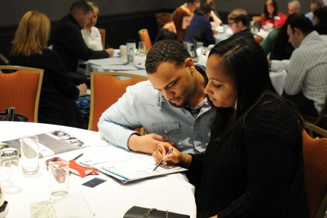 "Army Reserve Soldiers Spec. Bradley and Staff Sgt. Arianna Joe, who have been married for three months, review a hand-out together during a Strong Bonds event conducted at the Hilton Oak Brook Hills Resort in Oak Brook, Ill, April 8-10. Bradley and Arianna had also attended a Single Soldier Strong Bonds event long before getting married. Bradley said that foundation had helped him in many ways. ""Everybody should go to a Strong Bonds event - even the singles."" said Bradley. ""In the singles event I learned so much about myself - stuff I didn't even know. Now we're married and we're learning about what we do rather than what I do, because it's not about you and I anymore, it's about we."""