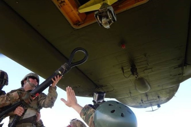 Riggers from 5th Quartermaster Theater Aerial Delivery Company and Greece's 865th Aerial Delivery Battalion hook a Type Five Palette System to a Greece Air Force Chinook cargo helicopter, April 5, at the Greek Air Force Base in Elefsis, Greece.