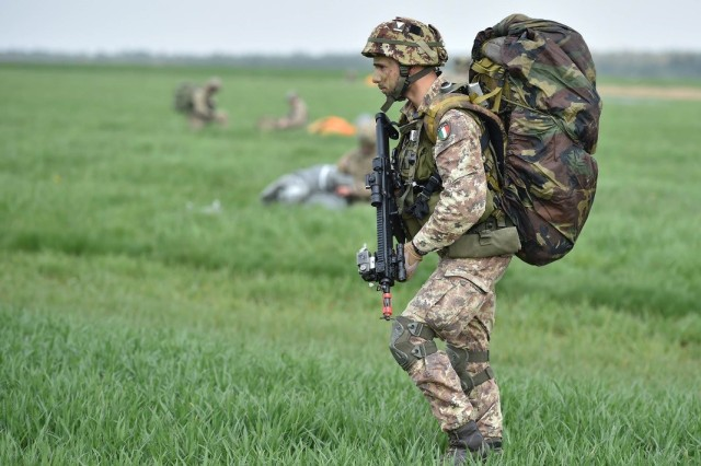 Paratroopers with the Italian Folgore Brigade take in large scale airborne operations during Exercise Saber Junction 16 on the Maneuver Rights Area near Hohenfels, Germany, April 12, 2016. Over 1000 paratroopers and multiple Container Delivery Systems bundles were deployed to provide initial logistical support for follow on missions. Saber Junction 16 will evaluate and assess the readiness of the U.S. Army's 173rd Airborne Brigade to conduct land operations in a joint, combined environment and to promote interoperability with participating Allied and partner nations. Countries participating in the exercise include Albania, Armenia, Bosnia and Herzegovina, Bulgaria, Hungary, Italy, Latvia, Lithuania, Macedonia, Moldova, Romania, Serbia, Slovenia, Sweden, the United Kingdom and the United States. (U.S. Army photo by Visual Information Specialist Gertrud Zach/released)