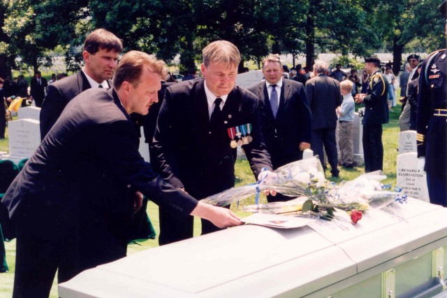 Friends, family and international officials gathered June 26, 2003, to lay Capt. Larry Thorne, missing in action for decades, to rest at Arlington National Cemetery. Thorne is a national hero in his birth country of Finland and a military hero in the country for which he swore allegiance and laid down his life--the United States. USASAC employee Andy Hollingsworth was instrumental in bringing one of the Green Beret's most legendary Soldiers home.