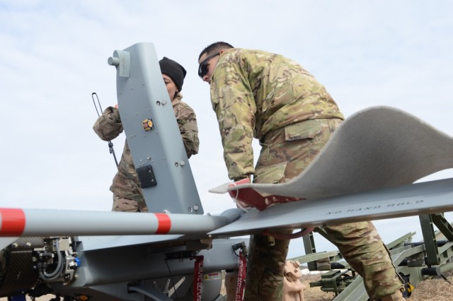 U.S. Army Sgt. Deanna Lucchesi, left, an RQ-7B Shadow crew chief, left, and Pfc. Reynaldo Carlo, right, an RQ-7B Shadow crew member, both with 2nd Cavalry Regiment, Engineer Squadron, stationed out of Vilseck, Germany, verify the correct control settings of the Shadow before they launch it during a test flight at Tapa Training Area, Estonia, April 5, 2016.