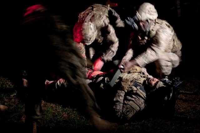 "Medics with the 173rd Brigade Support Battalion, 173rd Airborne Brigade rescue a an injured soldier after an enemy roadside bomb attacked their convoy as part of training during exercise Saber Junction 16 at the Joint Multinational Readiness Center in Hohenfels, Germany, April 8, 2016. ""If you make a mistake here, its better to make it here in training than out there in the real world,"" said Spc. Diego Guerra, a truck driver with the 173rd BSB. The exercise is designed to evaluate the readiness of the Army's Europe-based combat brigades to conduct unified land operations and promote interoperability in a joint, multination environment. Saber Junction 16 includes nearly 5,000 participants from 18 NATO and European partner nations."""