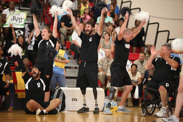 U.S. Army fans and teammates cheer as Army takes the lead in the sitting volleyball gold medal match against Team Air Force during the 2015 Department of Defense Warrior Games at Marine Corps Base Quantico, Va., June 28.