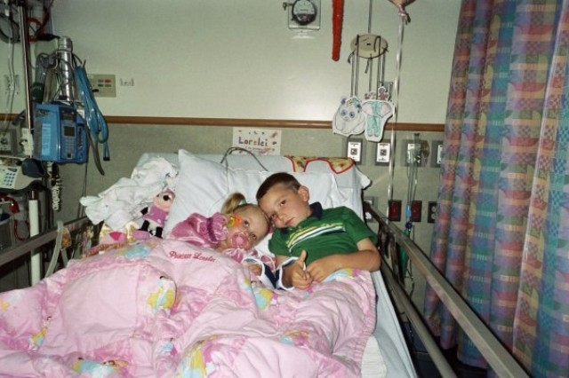 Cavan McIntyre-Brewer, now 14, comforts his sister, Lorelei, now 10, around the time of her third open heart surgery. Lorelei is Operation Homefront's 2016 Military Child of the Year for the Army. Cavan received the award in 2015 for his work with veterans and wounded warriors. (Photo courtesy of Chelle McIntyre-Brewer)