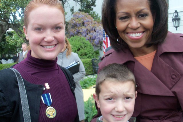 Chelle McIntyre-Brewer and her son Cavan, now 14, pose with First Lady Michelle Obama after Chelle received the Presidential Citizens Medal for her work advocating for wounded warriors, high-risk Army families and special needs families. She passed that passion onto her children and both Cavan and her 10-year-old daughter Lorelei have been honored as Military Child of the Year, in 2015 and 2015, respectively. (Photo courtesy of Chelle McIntyre-Brewer)