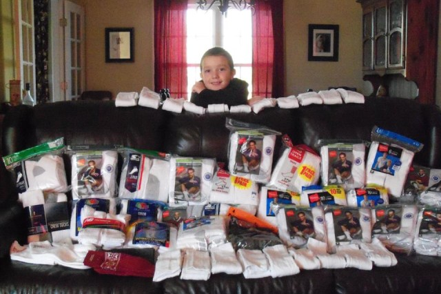 Cavan McIntyre-Brewer, 14, has helped almost 10,000 veterans by distributing socks and other personal items at veterans' homes through his organization, Socks for Vets. He was honored by Operation Homefront as the 2015 Military Child of the Year for the Army. His sister, Lorelie, 10, was born with half a heart and received the honor this year in recognition of her work to help other pediatric cardiology patients. (Photo courtesy of Chelle McIntyre-Brewer)