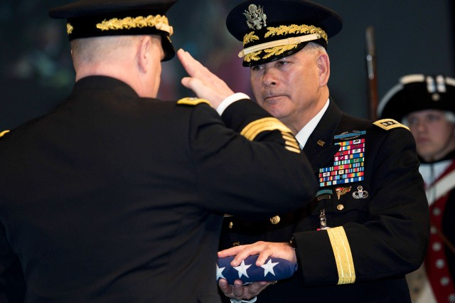 U.S. Army Gen. John F. Campbell receives the American flag and a salute from Army Chief of Staff Gen. Mark A. Milley during a retirement ceremony for Campbell inside Conmy Hall April 8 on the Fort Myer portion of Joint Base Myer-Henderson Hall. Campbell, a former Army vice chief of staff, retired after 37 years of military service. He is the second Army four-star general to retire in less than a week -- former U.S. Central Command Commander Gen. Lloyd Austin III retired in a separate ceremony at Fort Myer April 5.