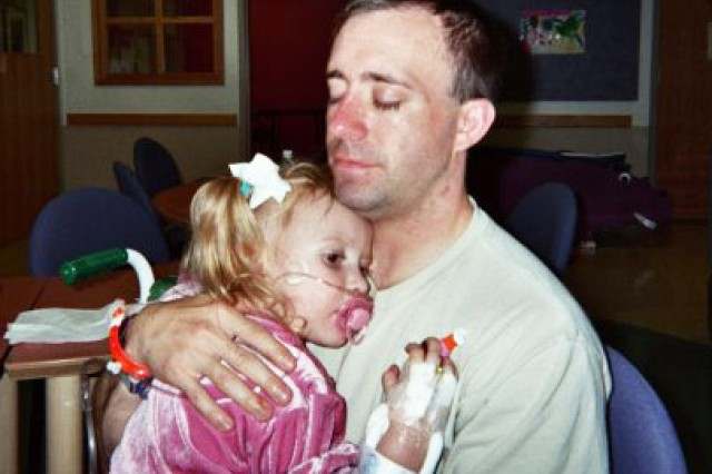 Capt. Steven Brewer holds his daughter, Lorelei, now 10 around the time of her third open heart surgery. After the surgery, Lorelei's lungs collapsed, leaving her drowning in fluid. Doctors put in extra tubes and they also tried a compression heart pillow. The pillow, however, was too big for a tiny, three-year-old girl so two years later she learned to sew and founded Heart Hugs, which distributes child-sized compression pillows to pediatric cardiology patients. Lorelei is Operation Homefront's 2016 Military Child of the Year for the Army. Her 14-year-old brother, Cavan, received the award in 2015 for his work with veterans and wounded warriors. (Photo courtesy of Chelle McIntyre-Brewer)