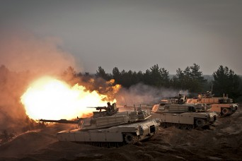 U.S. Soldiers fire ceremonial rounds from M1A2 Abrams tanks at the Adazi training area in Latvia in November 2014.