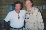 Retired Army Materiel Command Chaplain (Col.) Scott Carson shares a laugh with the late actor-comedian Robin Williams during one of Williams' Operation Iraqi Freedom USO tours.