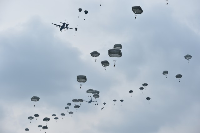 U.S. Army Paratroopers with the 173rd Airborne Brigade, the Italian Folgore Brigade and the British Army's 16 Air Assault Brigade, conduct large scale airborne operations during Exercise Saber Junction 16 on the Maneuver Rights Area near Hohenfels, Germany, April 12, 2016.