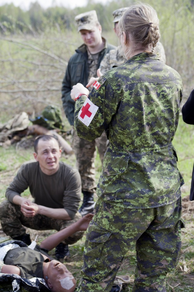 Canadian Soldier instructs on how to treat a chest wound