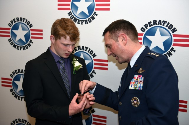 Air Force Lt. Gen. Joseph Lengyel, vice chief, National Guard Bureau, with John Trip Landon, National Guard Military Child of the Year 2016, Arlington, Va., April 14, 2016.